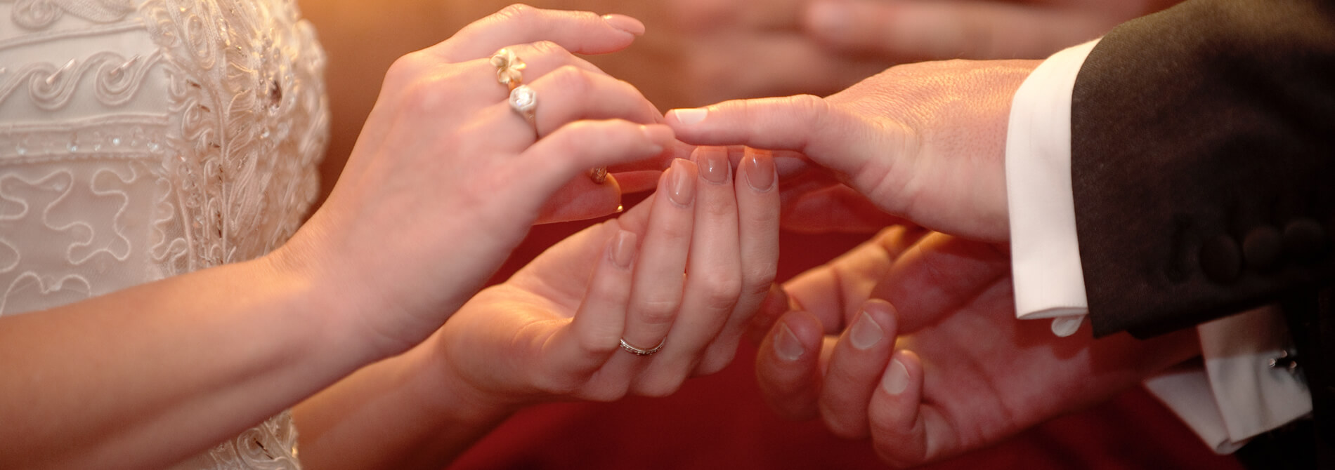 View of hands exchanging wedding rings